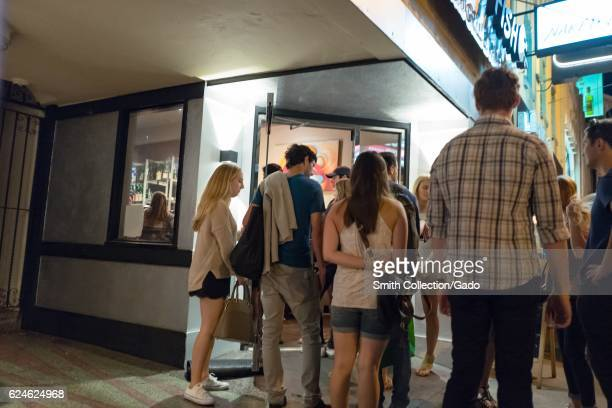 A small crowd of people wait outside of the entrance of a nightclub in the Marina neighborhood of San Francisco California October 8 2016