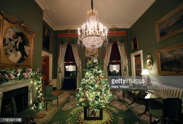 A small decorated Christmas tree stands in the middle of the Green Room at the White House December 2 2019 in Washington DC The White House expects...