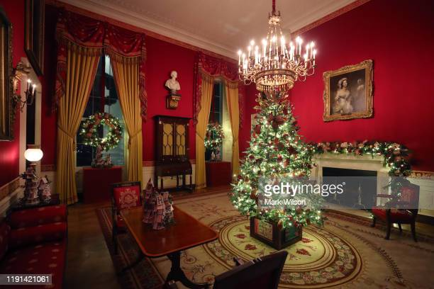 A small decorated Christmas Tree stands in the Red Room at the White House December 2 2019 in Washington DC The White House expects to host 100 open...