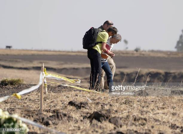 Small delegation from Austria pay respects to a mutual friend killed at the crash site of Ethiopian Airlines Flight 302 on March 13, 2019 in Ejere,...