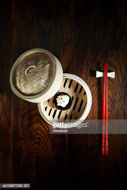 Small dessert in basket and chopstick, view from above