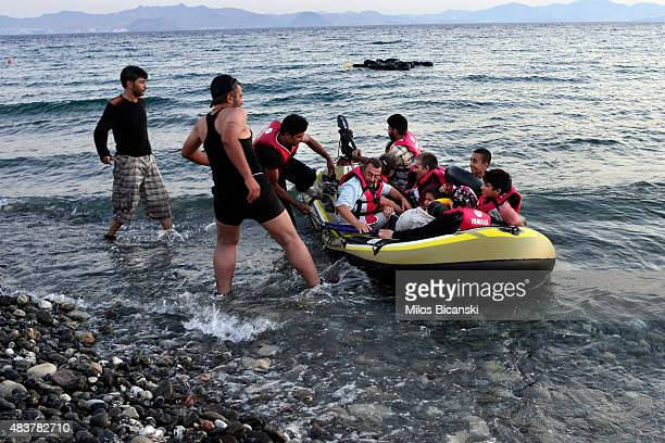A small dinghy overcrowded with Syrian migrants approaches a beach on the Greek island of Kos after crossing a part of the Aegean sea from Turkey to...