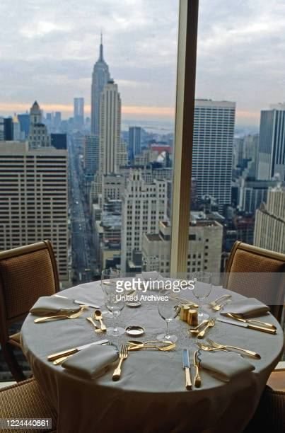 Small dining room of Adnan Kashoggi with view to the Empire State Building at Olympic Tower in New York, USA 1986.