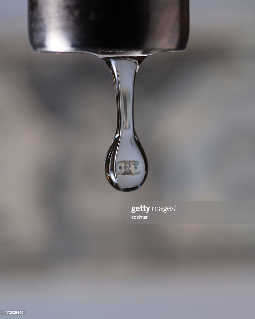 Small Dollar Image Inside A Close Up Photo Of A Faucet Drip Stock ...