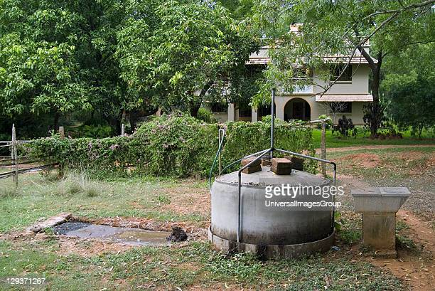 Small domestic biogas plant methane and carbon dioxide produced by bacterial degradation of organic matter is used as a fuel