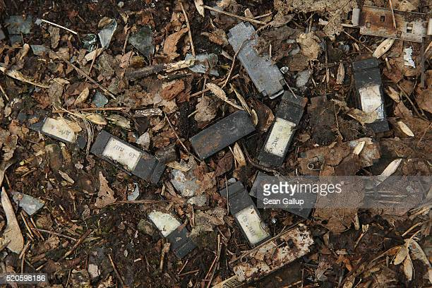 Small dosimeters that measure radiation dosage and used by emergency workers following the Chernobyl nuclear disaster lie scattered on the ground...