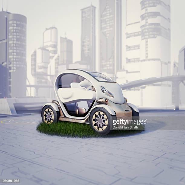Small eco-friendly car on pad of grass in futuristic city
