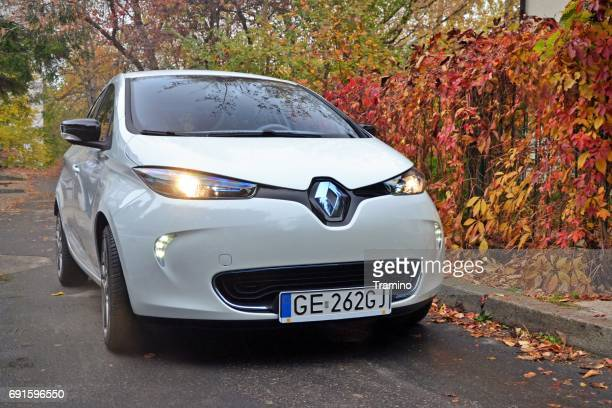 small electric car on the street in autumn scenery - renault stock pictures, royalty-free photos & images