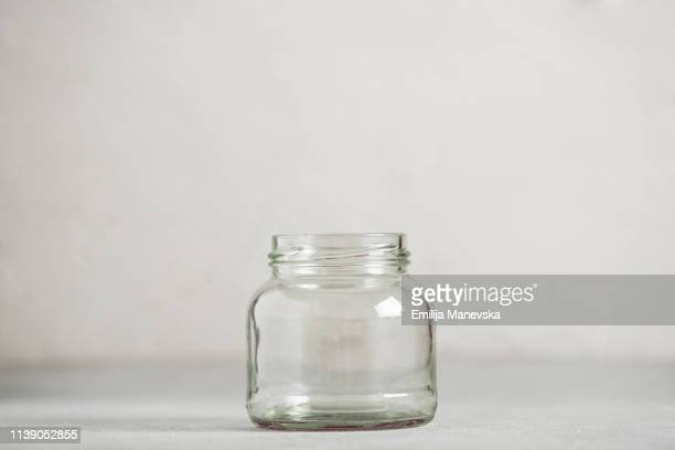 small empty jar - jar stock pictures, royalty-free photos & images