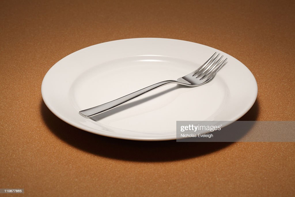 Small empty plate with fork : Foto de stock