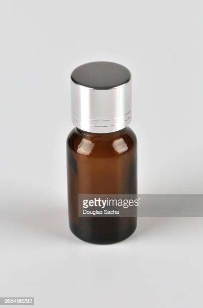 small essential oil health bottle on a white background - tea tree oil stock photos and pictures