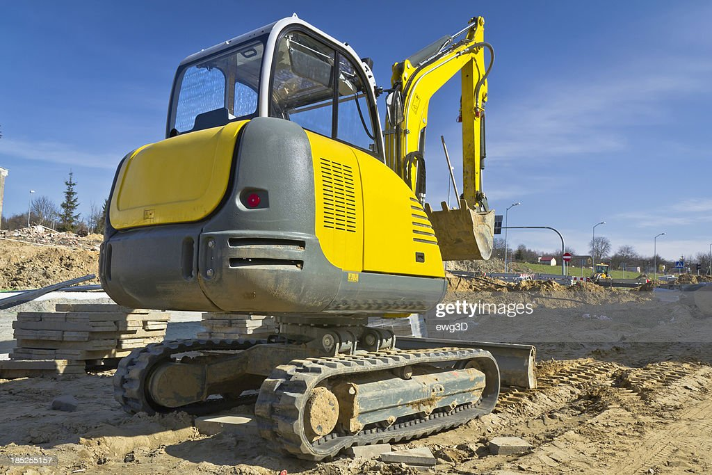 Small Excavator In New Highway Construction Stock Photo