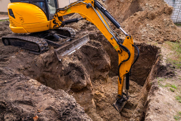 Small excavator working on a construction site. Construction works