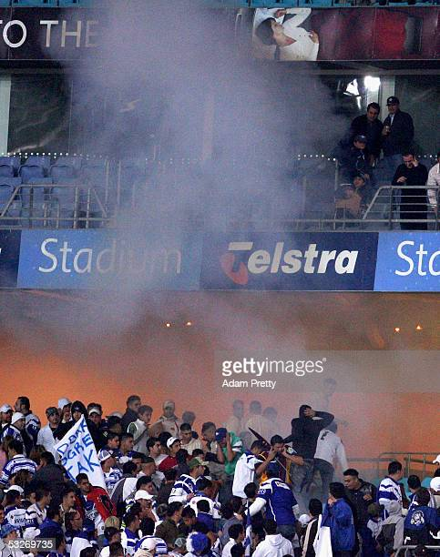 A small explosion creates panic in the stands during the round 20 NRL match between the Bulldogs and the Brisbane Broncos held at the Telstra Stadium...