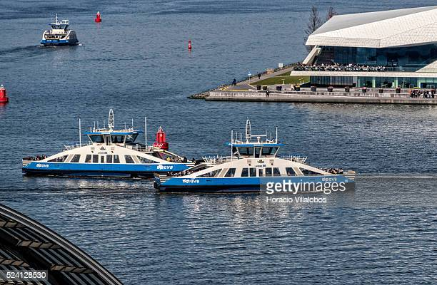 Small ferries sail through the harbor in Amsterdam Netherlands 23 April 2015 Amsterdam is one of the most popular tourist destinations in Europe...