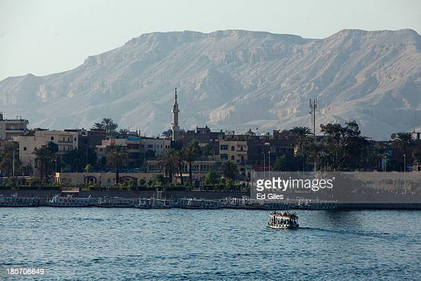 Small ferry boat prepares to dock on the East Bank of the River Nile on October 23, 2013 in Luxor, Egypt. Luxor, one of Egypt's major tourist...
