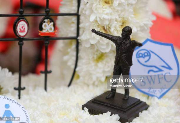A small figure of Bill Shankly sits on the Hillsborough memorial outside Anfield stadium the home of Liverpool Football Club