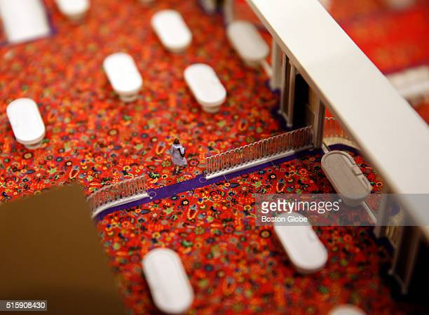 A small figure walks inside of a model of a proposed casino in Everett during a press conference in Medford Mass on March 15 2016