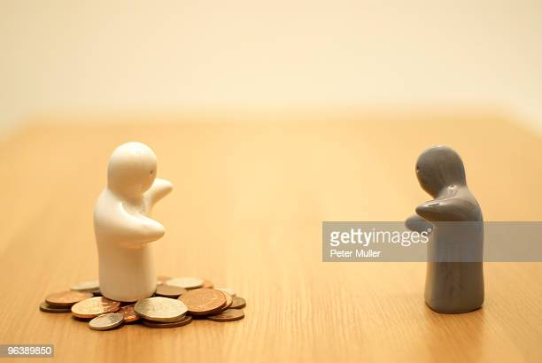 small figures with money