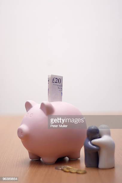 small figures with piggy bank