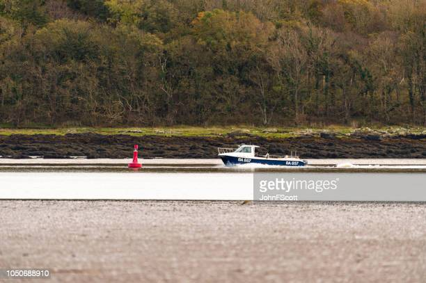 Small fishing boat on a Scottish estuary in Dumfries and Galloway