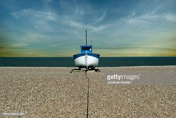 small fishing boat on gravel beach - dungeness stock pictures, royalty-free photos & images