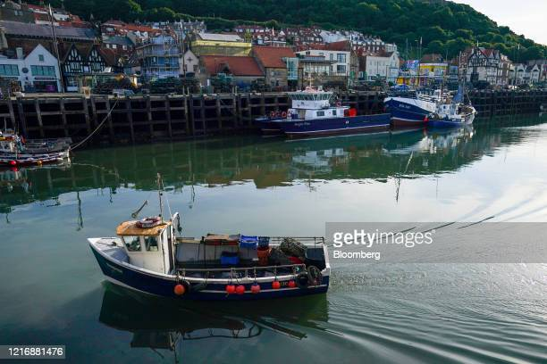 A small fishing boat returns to the harbour after checking its pots in Scarborough UK on Tuesday June 2 2020 The threat of a nodeal Brexit is back...