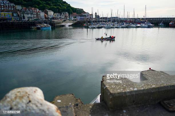 A small fishing boat sails out of the harbour in Scarborough UK on Tuesday June 2 2020 The threat of a nodeal Brexit is back and with it the risk...