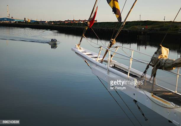 A small fishing boat sails past the ships moored alongside the quay during the North Sea Tall Ships Regatta on August 27 2016 in Blyth England The...