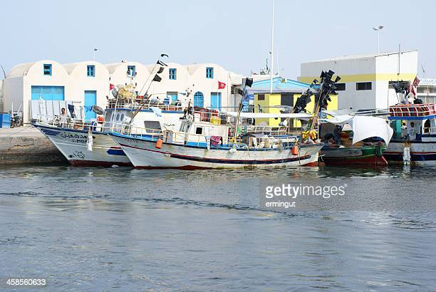 small fishing boats in houmt souk harbor - djerba - djerba stock pictures, royalty-free photos & images