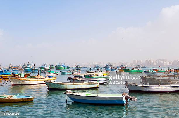 Small fishing boats in the harbor in Alexandria, Egypt
