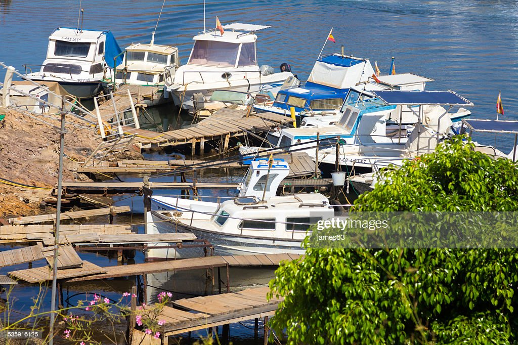 Small fishing boats on the old pier : Stock Photo