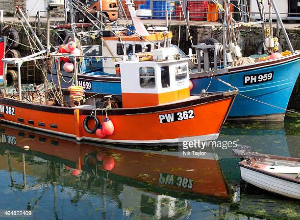 Small fishing trawlers in Mevagissey Harbour, Cornwall, UK