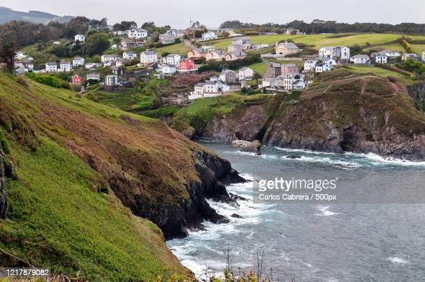 small fishing village on seashore, coana, asturias, spain - asturien stock-fotos und bilder