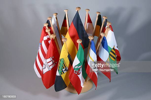 Small flags with the coat of arms of the German federal states the German flag in the middle Symbolic photo financial adjustment federal government...