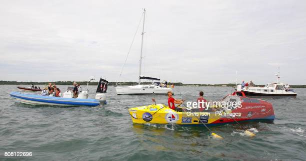 A small flotilla welcomes British Army doctors Captain Hamish Reid and Captain Nick Dennison of the Royal Army Medical Corps back to Lymington in...