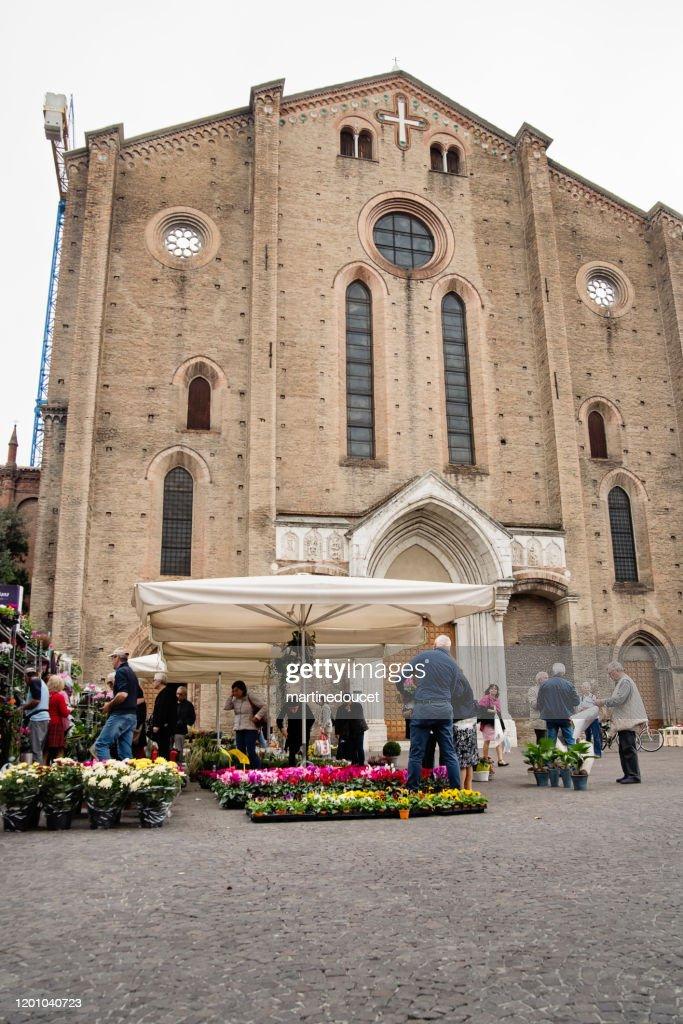 Small flower market near a church in Bologna, Italy. : Stock Photo