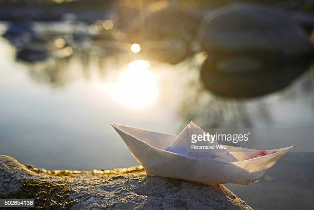 Small folded paper boat