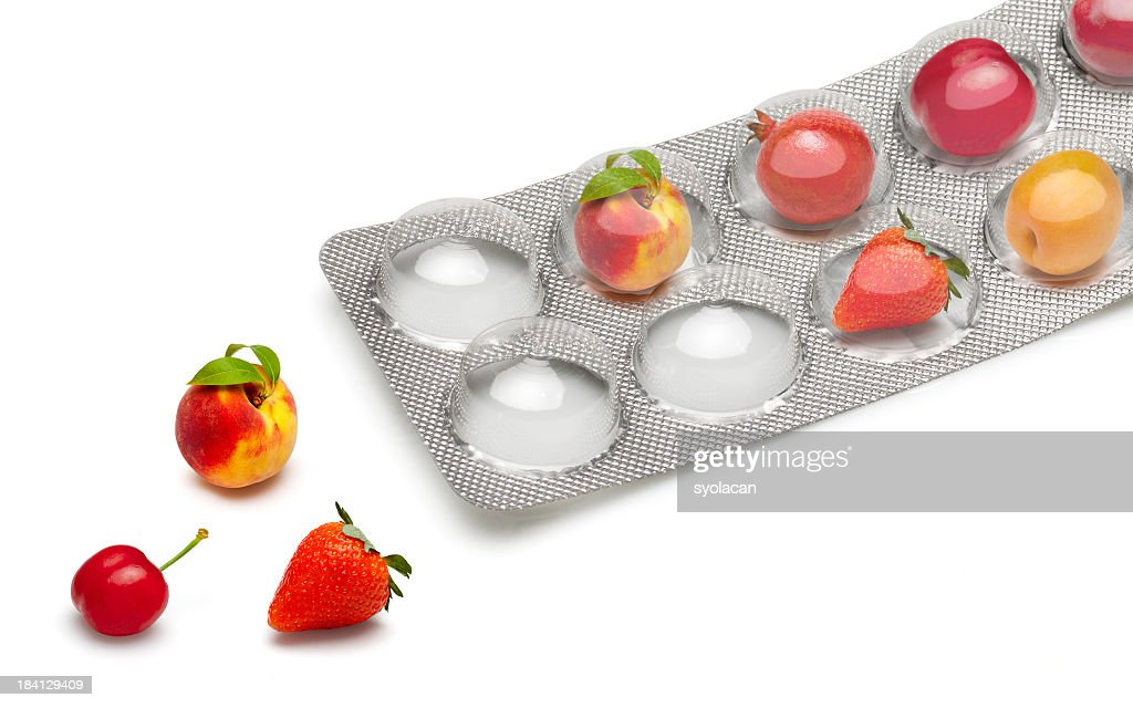 Small fruits in a pill blister packs : Stock Photo