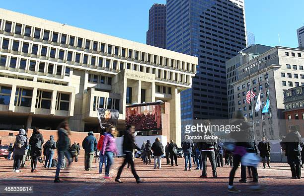 A small gathering watched the Mass for the late Boston mayor Thomas M Menino on a large screen outside Boston City Hall on November 3 2014