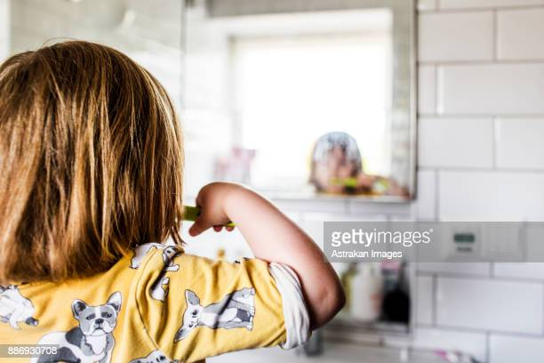 small girl (2-3) brushing teeth - brushing teeth stock pictures, royalty-free photos & images