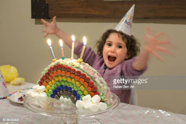 small girl celebrating her 4th birthday - rafael ben ari stock-fotos und bilder