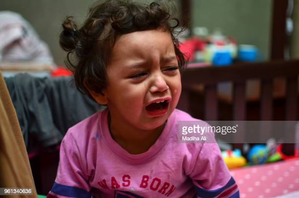 a small girl crying with sorrow - dead girl stock pictures, royalty-free photos & images