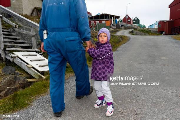 Small girl curious about visitors to her village. Kangaamiut, Gammel Sukkertoppen, Qeqqata Municipality, Greenland.