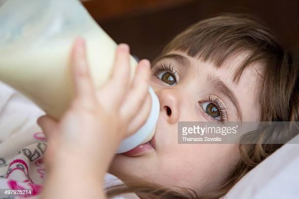 Small girl drinking milk