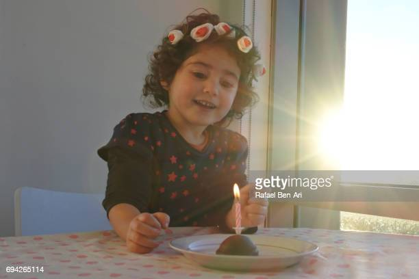 Small girl having a birthday party