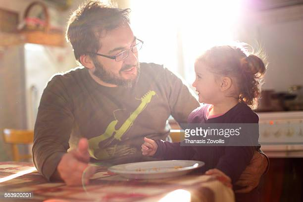small girl having fun with her father - leanintogether stock pictures, royalty-free photos & images