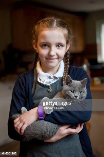 Small girl holding kitten