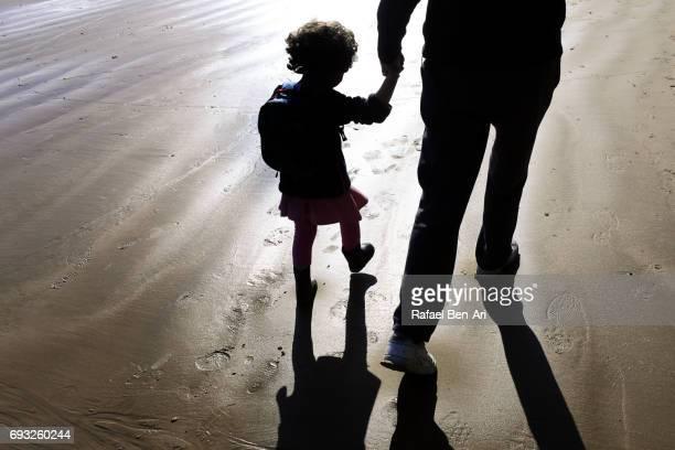small girl holds grandparent hand - rafael ben ari imagens e fotografias de stock