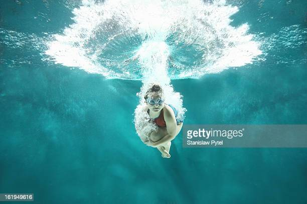 small girl jumping into the water- underwater view - underwater stock pictures, royalty-free photos & images
